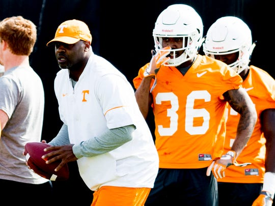 Tennessee cornerbacks coack Terry Fair drills with