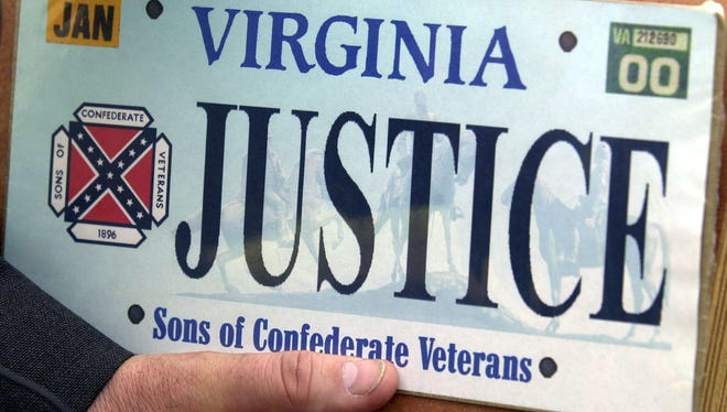 This Thursday May 2, 2002 file photo shows a sample of the Sons of Confederate Veterans specialty Virginia state license plate in Richmond, Va. Virginia Gov. Terry McAuliffe said Tuesday, June 23, 2015 that he's moving to have the Confederate flag banished from state license plates in the wake of a massacre at a black church in Charleston, South Carolina.