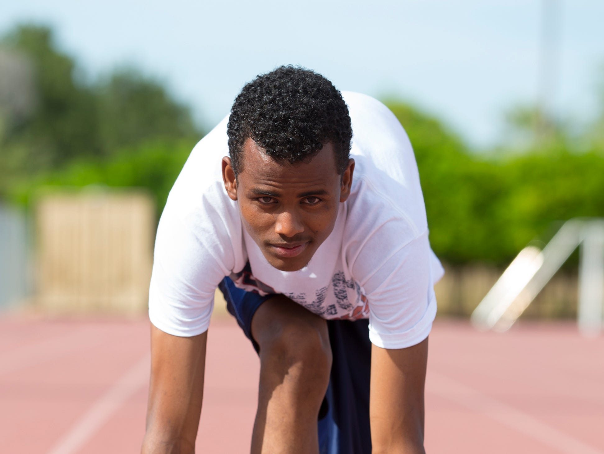 McClintock High School distance runner Abdi Aden, who is from Kenya, works part-time to make money to send to his mother. He found out his mother was still alive last year and is motivated at work, school and on the track to see her again.