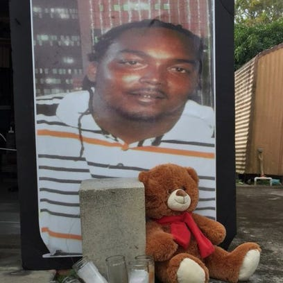 A picture of Gregory Hill Jr., rests against the garage