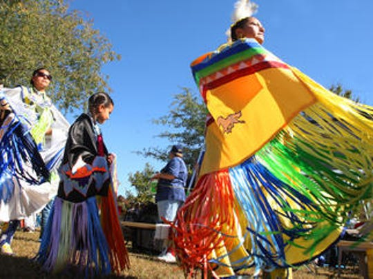 American Indian women and children participate during the grand entry event at a previous Native American Indian Association of Tennessee powwow.