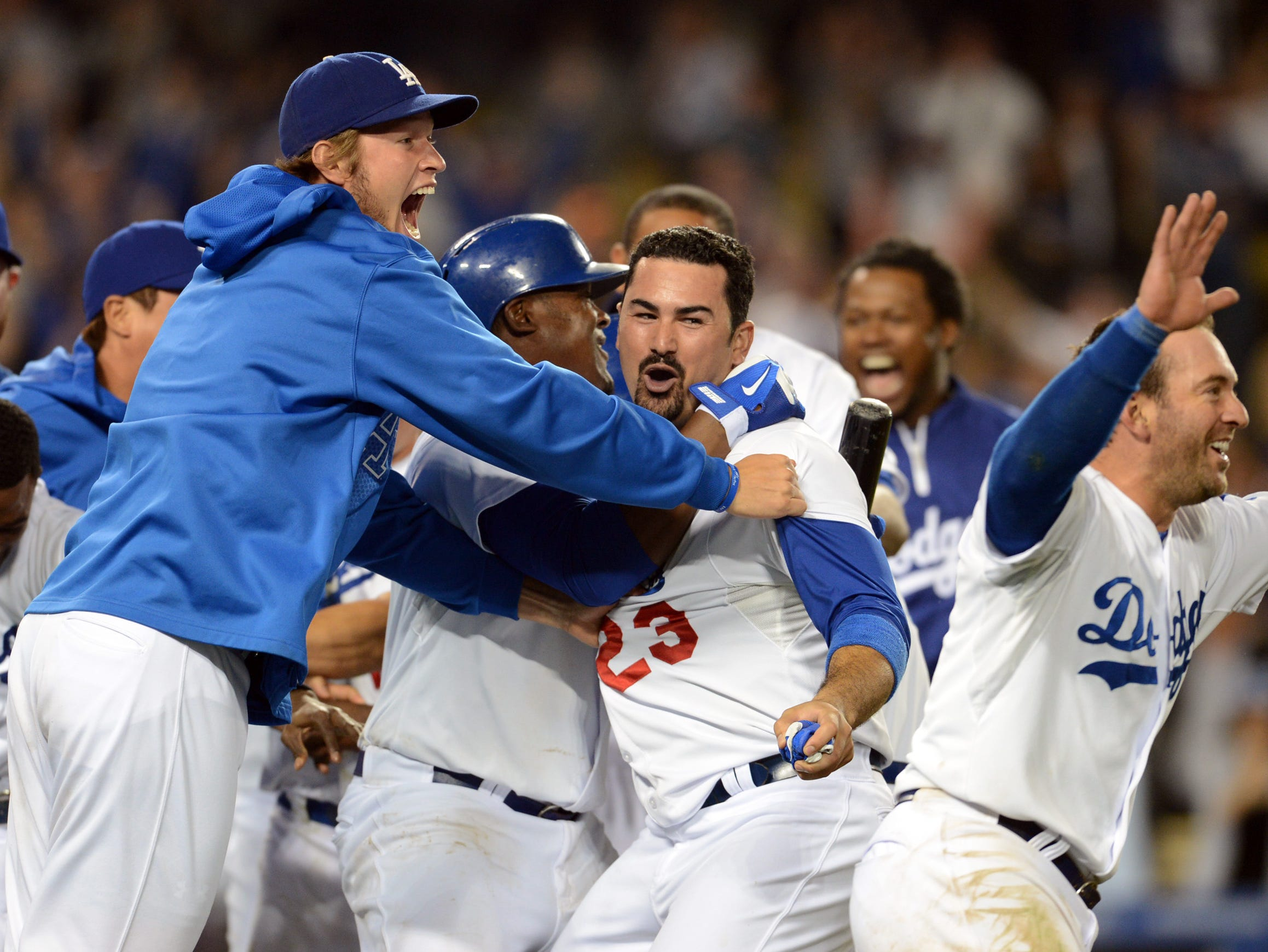 Aug. 9: Los Angeles Dodgers celebrate after first baseman Adrian Gonzalez crossed the plate in the ninth inning of the game for the winning run against the Tampa Bay Rays.