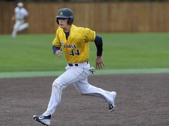Augustana's #44 Jack Goihl runs to third base against