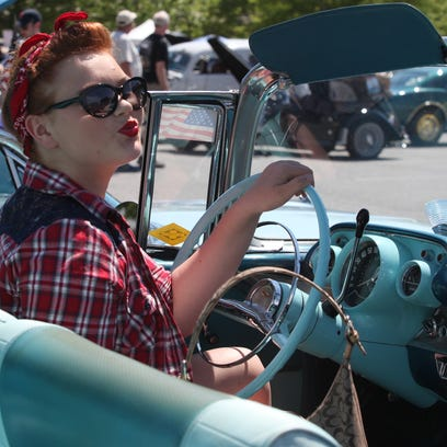 Christina Bello, of New Castle, sits behind the wheel