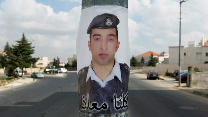 A poster with a picture of Jordanian pilot, Lt. Muath