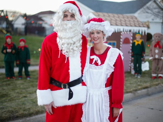 Brooke and Andy McHose of Ankeny, along with their children, dress up as Santa and Mrs. Claus, elves and a gingerbread man to get into the holiday spirit in their Ankeny neighborhood. This year the tradition of Gingerbread Lane is back, after a bad ice storm damaged properties and decorations years ago.