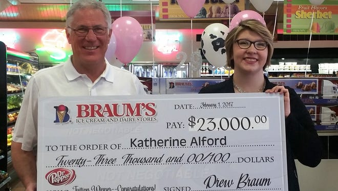 The Braum's management team, including Braum's President and CEO Drew Braum, presented Katherine Alford with a check for $23,000 to go toward her tuition expenses at Missouri State University. She won the prize by entering the Braum's-Dr Pepper Tuition Giveaway Contest.