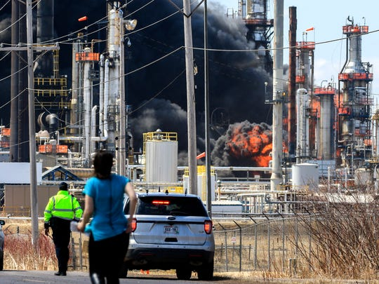 A large fireball erupts during a series of fires and explosions at the Husky Energy oil refinery in Superior, Wis.