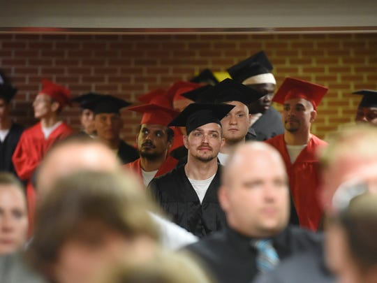 Graduates at the South Dakota Sate Penitentiary in Sioux Falls get ready for their ceremony on Thursday, May 10, 2018.