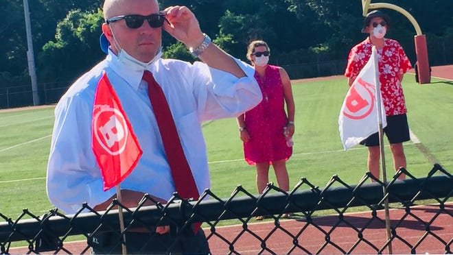 Supt. Meg Mayo-Brown sent a message to families and students around 7:35 a.m. Monday, about 15 minutes after in-person classes started at the high school for the first time in more than six months. The message said Clark had been placed on leave.