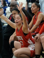 Mya Kraus, center, cheers for her Hueneme teammates alongside of Fale Carillo, left, and her sister Kaili Kraus during the CIF-SS Division 5AAA championship game.  The Vikings beat Desert Christian Academy 59-33 for the program's first CIF title.