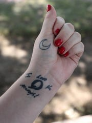 "Skyler Spina shows off a tattoo of a ""backward"" Q,"