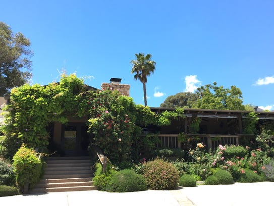 Roses, lavender and flowering vines surround the entrance