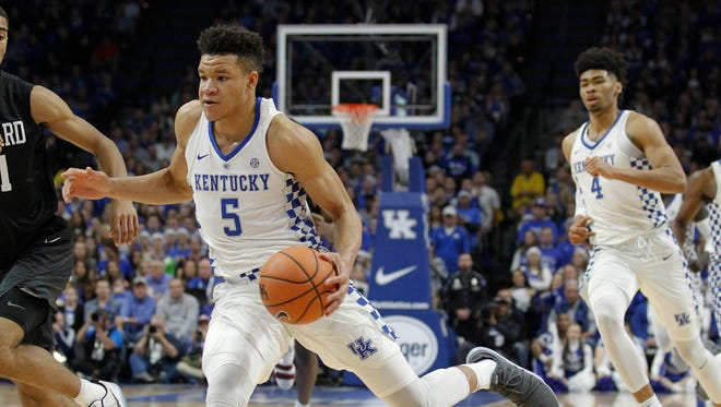 Kentucky Wildcats forward Kevin Knox (5) dribbles the ball against the Harvard Crimson in the first half at Rupp Arena in Lexington, Kentucky, on Saturday, Dec. 2, 2017.