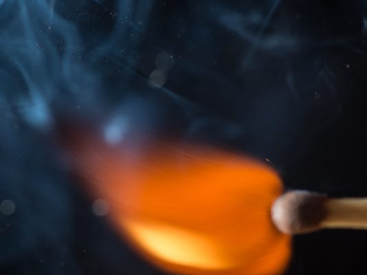 Match with smoke and fire on black background  copyspace