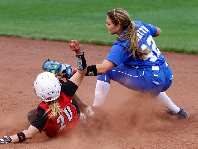 University of Kentucky's Ansley Smith (42) tags out University of Louisville's Whitney Arion (20) and second base during their game at Ulmer Stadium  in Louisville, Kentucky.       April, 2014