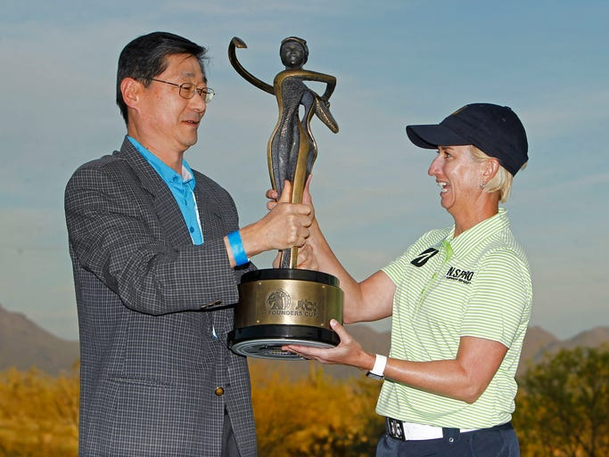 JTBC  Vice Chairman Philho Song presents Karrie Webb with her trophy following the final round of the  of LPGA's JTBC Founders Cup Sunday, March 23, 2014 at Wildfire Golf Club at JW Marriott Phoenix Desert Ridge Resort & Spa in Phoenix, Ariz.