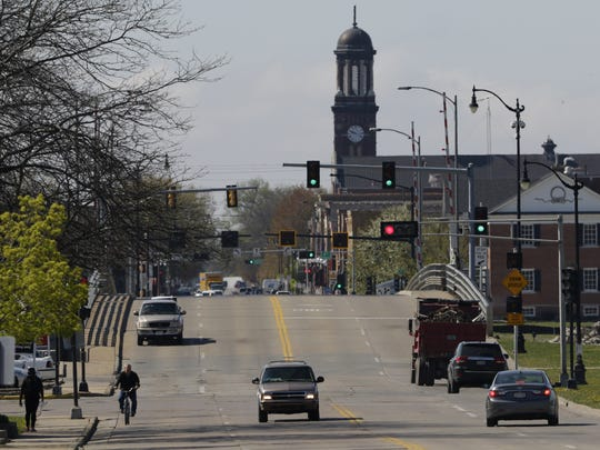 Vehicles travel over the Oregon Street bridge Friday, May 5, 2017, in Oshkosh. The Oshkosh Common Council is evaluating plans to replace or resurface the Oregon Street drawbridge, which is nearing the end of its useful life.