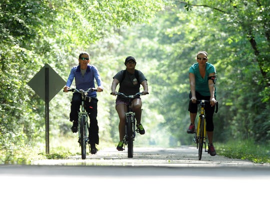 Cyclists ride bicycles on the Longleaf Trace near Jackson Road Station in this Hattiesburg American file photo.