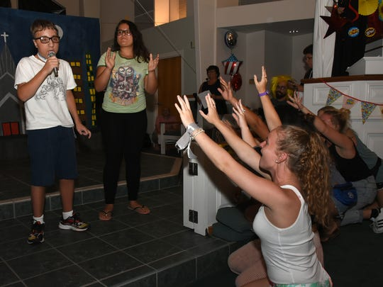 """Groupies"" rush the stage for a vocal performance. Camp Able completed a week of activities Saturday evening with a talent show at St. Mark's Episcopal Church."