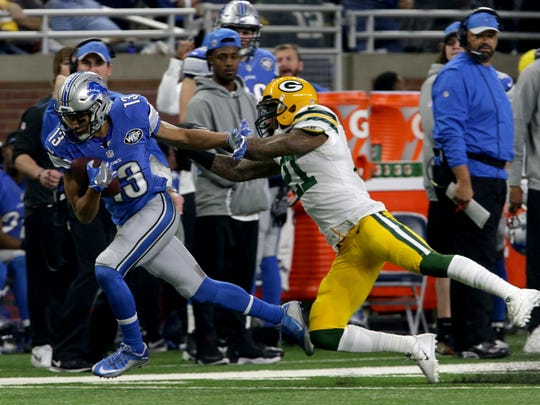 Lions wide receiver TJ Jones catches the ball for a