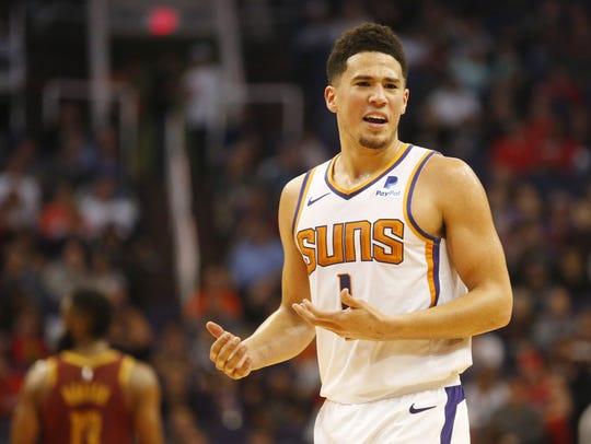Phoenix Suns guard Devin Booker (1) argues a call against