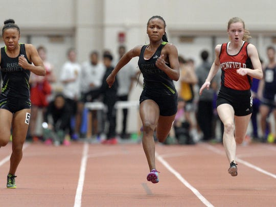 Rush-Henrietta's Lanae-Tava Thomas, center, wins the Class A 55 meter dash with a time of 6.95 ahead of teammate Jaelyn Davis, left, and Penfield's Abby Frank, right, during Section V Class A/B Winter Track & Field Championships at RIT on Thursday, Feb. 16, 2017.