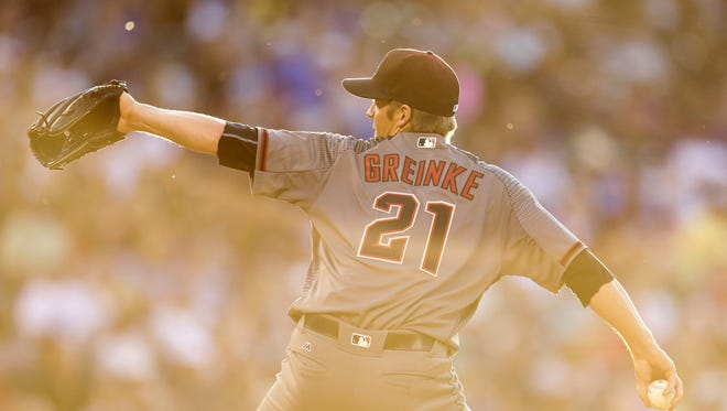 Jun 23, 2016: Arizona Diamondbacks starting pitcher Zack Greinke (21) pitches in the third inning against the Colorado Rockies at Coors Field.