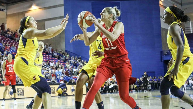 Washington Mystics forward Elena Delle Donne (11) drives to the basketball as Indiana Fever forward Candice Dupree (4) defends in the second period of a WNBA preseason basketball game between the Indiana Fever and the Washington Mystics at the Bob Carpenter Sports Convocation Center in Newark on Saturday, May 12, 2018.