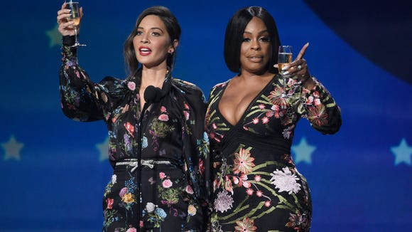 Host Olivia Munn, left, and Niecy Nash toasted the