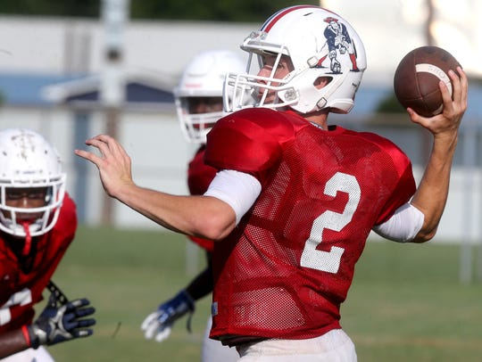 Oakland Brevin Linnell (2) throws a pass during practice