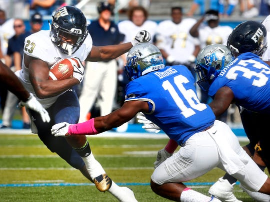 MTSU's Khalil Brooks (16) moves in to tackle FIU's Napoleon Maxwell (23) in a game last season.