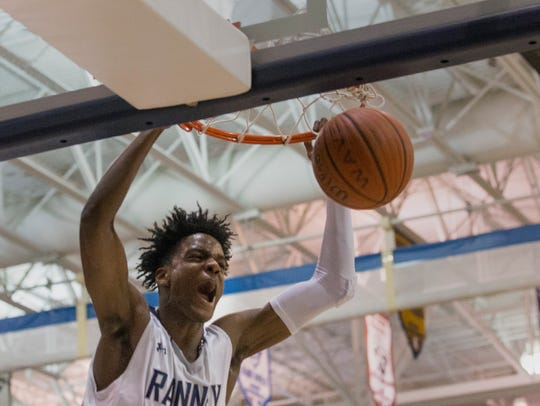 Ranney's Bryan Antoine dunks during first half action.