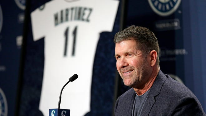 Former Mariners designated hitter Edgar Martinez smiles as he speaks at a news conference Tuesday announcing the retirement of his jersey No. 11 this coming summer.