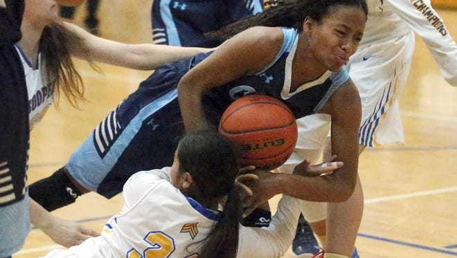 Morgan Herbert, 14, of Chapin takes a spill while going after the ball with Danielle Blackmon, 34, of Eastwood Saturday.