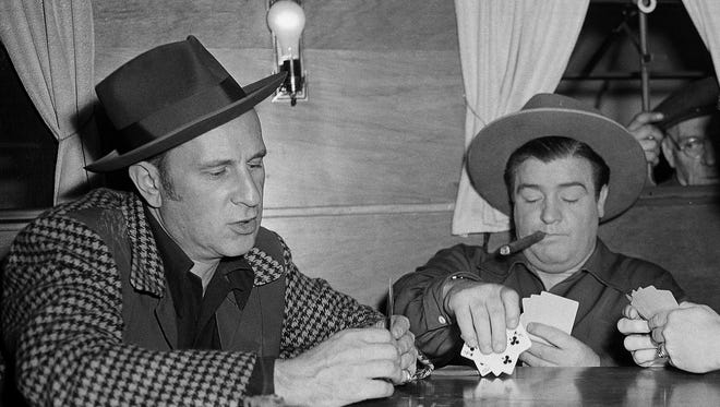 Unknown AP In this March 2, 1945, photo, Bud Abbott, left, and Lou Costello play cards on set in Los Angeles.