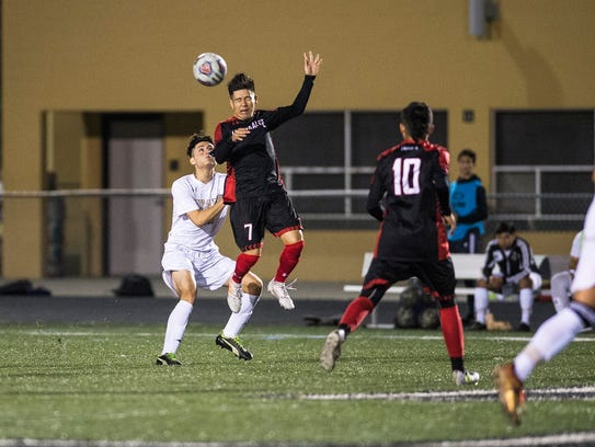 Immokalee High School's Juan Velasquez goes up for