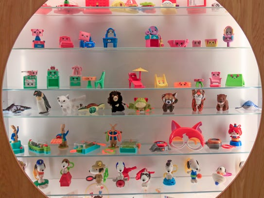 McDonald's Happy Meal toys from past years are displayed