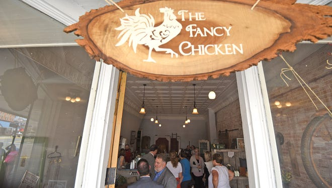 Visitors tour the new Fancy Chicken store in Downtown Shelby on Friday.