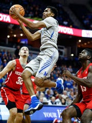 Memphis guard Jeremiah Martin (middle) drives for a layup against Houston on Feb. 22. Martin's season was cut short after a he injured his foot during the game against the Cougars.