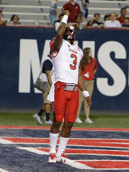 Utah quarterback Troy Williams (3) celebrates after scoring a touchdown against Arizona in the second half during an NCAA college football game, Friday, Sept. 22, 2017, in Tucson, Ariz. Utah defeated Arizona 30-24. (AP Photo/Rick Scuteri)