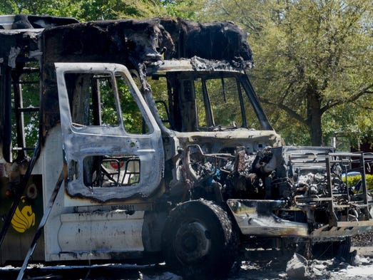 The charred remnants of a UCF shuttle that caught fire