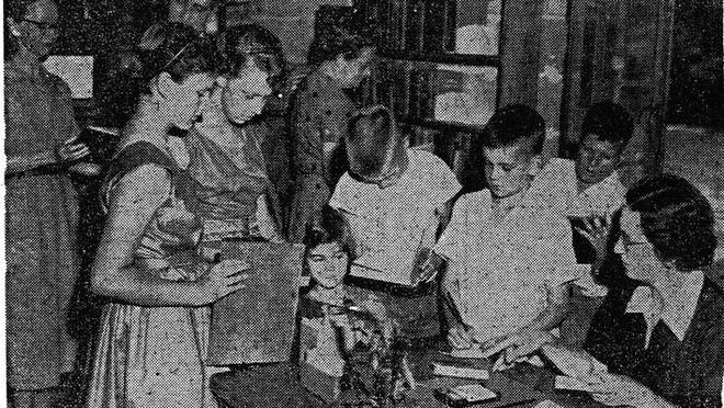 The Northport branch of the Tuscaloosa County Library opened in the Northport Community Center, May 10, 1955:  Shown are librarian Mrs. T.A. Edgeworth as she checks out a book to Ronnie Hamner as other children await their turn. Miss Barbara Davis, Tuscaloosa County librarian, and Dr. C.B. Wicks, chairman of the Northport Park and Recreation Board, are seen in the background. Comments? Reach bettyslsowe6@gmail.com.