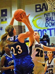 Stamford's Taylor Beeson puts up a baseline jumper