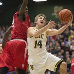 University of Vermont's Cam Ward drives past Stony Brook's Jameel Warney on Saturday.