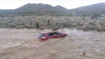 Rural Metro: Vehicle rescue in Cave Creek flooded creek bed