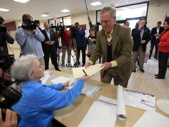 Senate Republican leader Mitch McConnell votes at Bellarmine