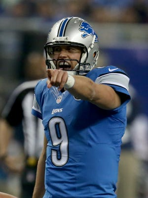 Detroit Lions QB Matthew Stafford makes a call during second half action against the Chicago Bears on November 27, 2014 at Ford Field.