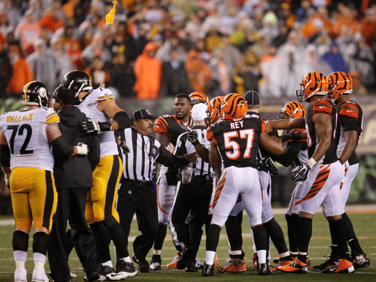A flag gets thrown on Adam Jones after he made contact with an official while yelling at Pittsburgh linebackers coach Joey Porter on Saturday night in the AFC Wild-Card Game at Paul Brown Stadium.