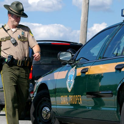 A Vermont State Trooper approaches a vehicle stopped for excessive speed on I-89 in Middlesex.